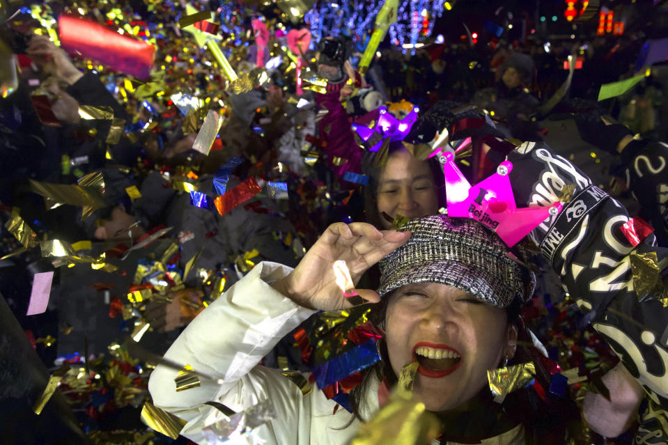 People celebrate the arrival of the year 2020 at a New Year's Eve countdown event near the 2022 Beijing Winter Olympic headquarters in Bejing, Wednesday, Jan. 1, 2020. Revellers around the globe are bidding farewell to a decade that will be remembered by many for the rise of social media, the Arab Spring, the #MeToo movement and, of course, President Donald Trump. (AP Photo/Ng Han Guan)
