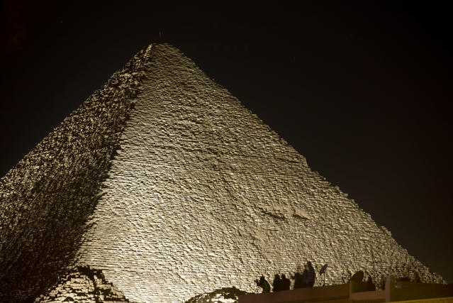 <p>Visitors film the light on the historical site of Giza Pyramids as they celebrate the New Year in Egypt, Monday, Jan. 1, 2018. (Photo: Amr Nabil/AP) </p>