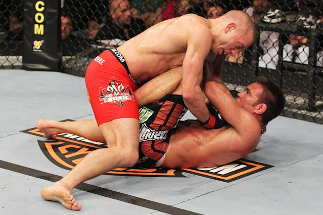 TORONTO, ON - APRIL 30: Georges St-Pierre (top) grapples with Jake Shields during their Welterweight Championship bout at UFC 129 in the Rogers Centre on April 30, 2011 in Toronto, Ontario. (Photo by Al Bello/Zuffa LLC/Zuffa LLC via Getty Images)