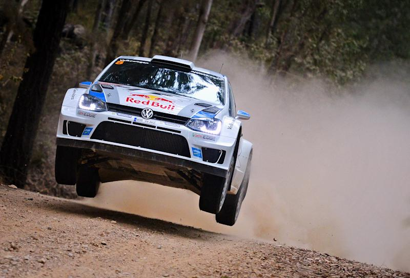 In this photo provided by Rally Australia, Sebastien Ogier of France races his car during a road stage of the Rally Australia near Coffs Harbour, Australia Friday, Sept. 13, 2013. Ogier won all six road stages at Rally Australia on Friday to take a commanding overall lead and leave him in a strong position to clinch the series title this weekend. (AP Photo/Rally Australia)