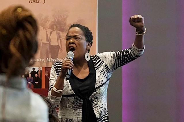 """In this June 20, 2019 photo provided by Meredith Williams, Jaribu Hill speaks at the Mississippi Civil Rights Museum in Jackson, Miss., during a reception honoring the life of civil rights activist Unita Blackwell. Hill didn't opt for law school until her early 40s. She'd been a singer, actress, teacher and labor organizer before learning a college classmate had become head of a group for black female judges. """"I can do that, too,"""" she thought. Hill has since become a leading civil rights and workers' rights lawyer in Mississippi and now, at 70, she's part of a nationwide network of attorneys helping women without much money pursue often-costly sexual misconduct cases. (Meredith Williams via AP)"""