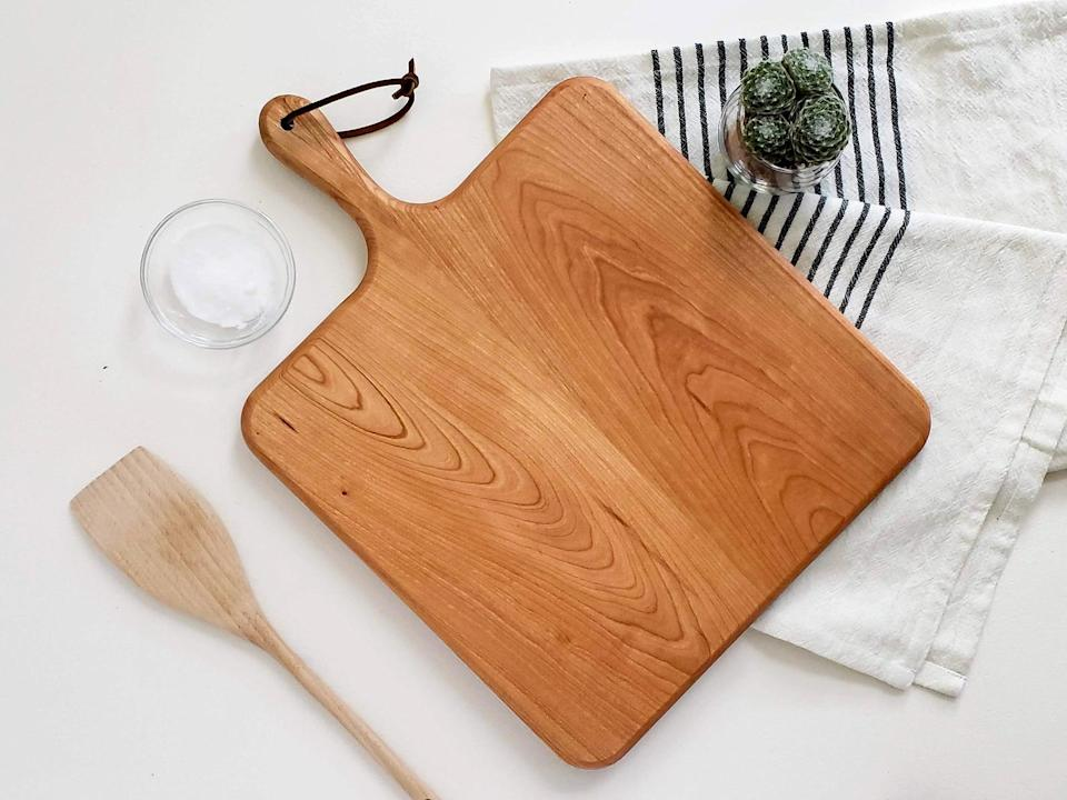 <p>You can never go wrong with the <span>Small Cherry Wood Square Charcuterie Board with Paddle</span> ($30). It's a basic cheese board everyone will enjoy!</p>