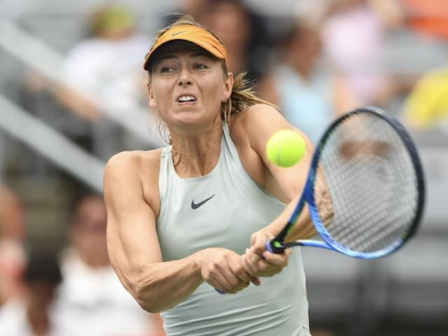Maria Sharapova hits a return against Daria Kasatkina during her quickfire win (AFP Photo/Minas Panagiotakis)