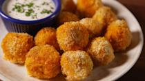 """<p>A hearty spritz of cooking spray — before this app goes in the oven, then again halfway through — is the key to getting them golden without frying.</p><p>Get the recipe from <a href=""""https://www.delish.com/cooking/recipe-ideas/recipes/a51023/buffalo-chicken-bites-recipe/"""" rel=""""nofollow noopener"""" target=""""_blank"""" data-ylk=""""slk:Delish"""" class=""""link rapid-noclick-resp"""">Delish</a>.</p>"""