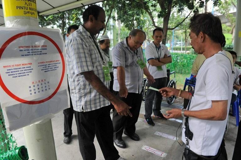 Volunteers helping residents of Punggol East cast their ballots at one several polling stations in the estate.
