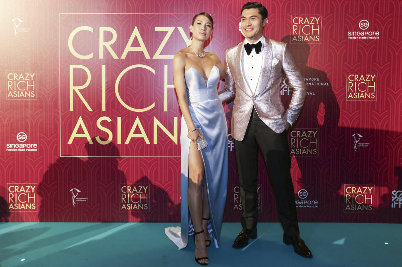 <p>British-Malaysian actor Henry Golding and wife Liv Lo pose for photographers at the Singapore premiere of 'Crazy Rich Asians' on 21 August 2018. (PHOTO: Yahoo Lifestyle Singapore) </p>