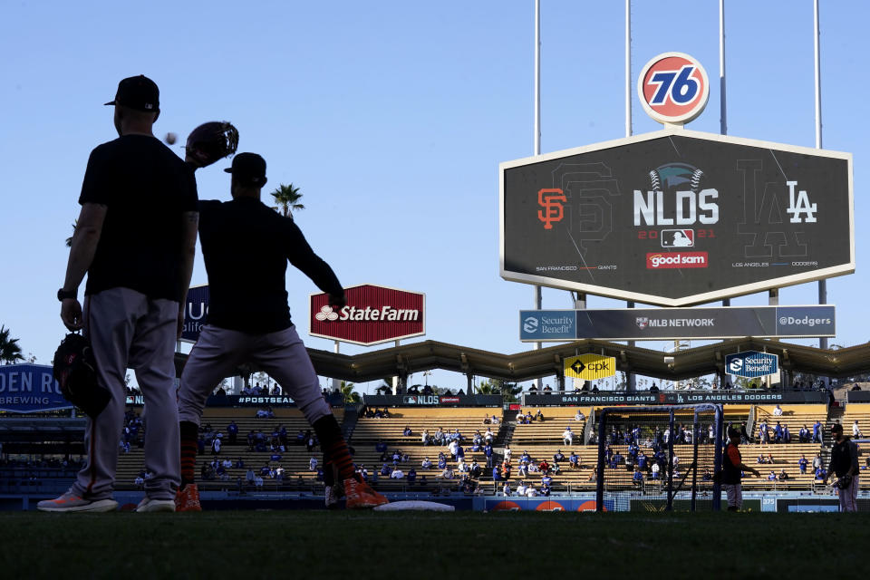 San Francisco Giants players warm up at Dodger Stadium before Game 4 of the baseball team's National League Division Series against the Los Angeles Dodgers, Tuesday, Oct. 12, 2021, in Los Angeles. (AP Photo/Ashley Landis)