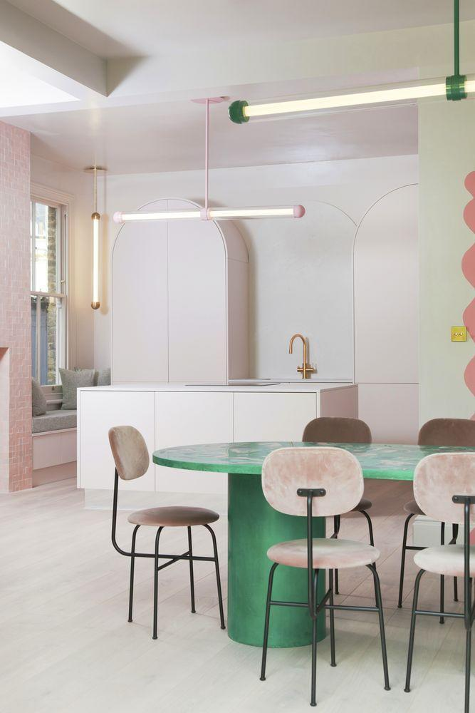 """<p>It only takes a splash of one daring hue to make a muted colour palette feel fresh and exciting. In this kitchen by John Lewis of Hungerford, designed by 2LG, an emerald green dining table adds pep to a pale pink palette. <a href=""""https://www.john-lewis.co.uk/"""" rel=""""nofollow noopener"""" target=""""_blank"""" data-ylk=""""slk:john-lewis.co.uk"""" class=""""link rapid-noclick-resp"""">john-lewis.co.uk</a></p>"""