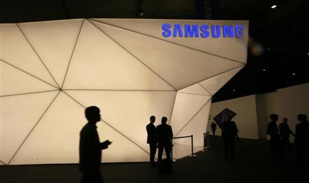 Visitors walk past the Samsung stand at the Mobile World Congress in Barcelona