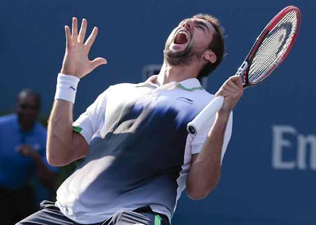 Marin Cilic, of Croatia, reacts after defeating Tomas Berdych, of the Czech Republic, during the quarterfinals of the 2014 U.S. Open tennis tournament, Thursday, Sept. 4, 2014, in New York. (AP Photo/Julio Cortez)