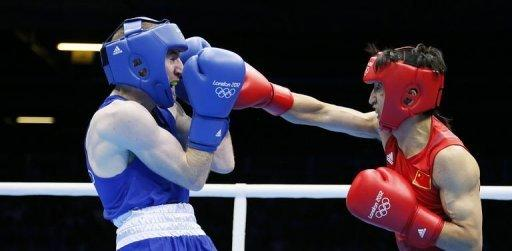 Zou Shiming of China (in red) defends against Paddy Barnes of Ireland (in blue) during the men's Light Flyweight (48kg) boxing semi-finals of the 2012 London Olympic Games. Zou won gold on August 10