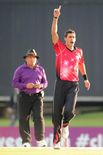 PRETORIA, SOUTH AFRICA - OCTOBER 26: (SOUTH AFRICA OUT) Mitchell Starc celebrates the wicket if Heino Kuhn during the Karbonn Smart CLT20 Semi Final match between Nashua Titans and Sydney Sixers at SuperSport Park on October 26, 2012 in Pretoria, South Africa (Photo by Duif du Toit/Gallo Images/Getty Images)