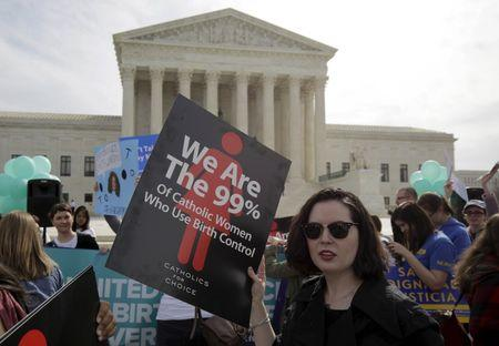 Supporters of contraception rally before Zubik v. Burwell is heard by the U.S. Supreme Court in Washington