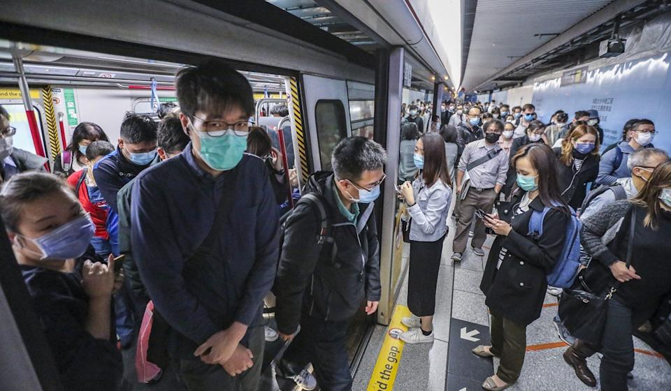 Masked passengers are seen exiting an MTR train in Hong Kong's Admiralty area on March 20. Photo: Felix Wong