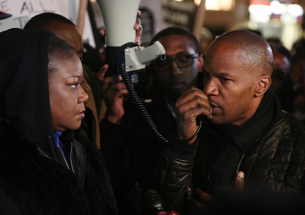 NEW YORK, NY - FEBRUARY 26:  Actor Jamie Foxx (R) speaks with Sybrina Fulton (L), mother of Trayvon Martin, during a candlelight vigil in Union Square on February 26, 2013 in New York, New York. Vigils were held in Florida and New York on the one year anniversary of teenager Trayvon Martin's shooting death by George Zimmerman in Florida.  (Photo by Mario Tama/Getty Images)