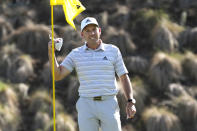 Sergio Garcia, of Spain, celebrates as he take his ball out of the cup after making a hole in one on the fourth hole to win his playoff against Lee Westwood, of England, during a third round match at the Dell Technologies Match Play Championship golf tournament Friday, March 26, 2021, in Austin, Texas. (AP Photo/David J. Phillip)