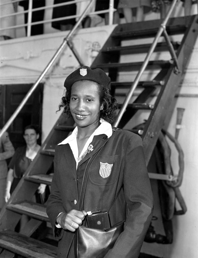 File-This file photo from Aug. 17, 1948, shows U.S. Olympic team member Alice Coachman arriving from London on the U.S.S. Washington into New York City. Coachman became the first black woman to win an Olympic gold medal with her win in the high jump in the 1948 Olympics in London. Coachman Davis, died early Monday, July 14, 2014, in south Georgia. She was 90. (AP Photo/John Rooney, File)