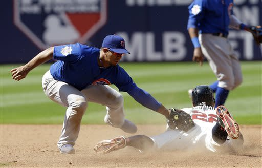 Atlanta Braves' Jason Heyward (22) is tagged out by Chicago Cubs shortstop Alberto Gonzalez while trying to steal second base in the seventh inning of baseball game in Atlanta, Sunday, April 7, 2013. (AP Photo/John Bazemore)