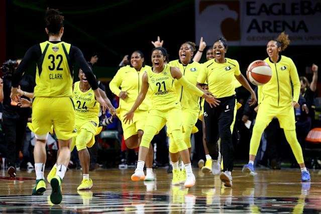 "Members of the <a class=""link rapid-noclick-resp"" href=""/wnba/teams/sea"" data-ylk=""slk:Seattle Storm"">Seattle Storm</a> celebrate after defeating the <a class=""link rapid-noclick-resp"" href=""/wnba/teams/was"" data-ylk=""slk:Washington Mystics"">Washington Mystics</a> 98-82 to win the WNBA Finals at EagleBank Arena on September 12, 2018, in Fairfax, Virginia. (Photo by Rob Carr/Getty Images)"