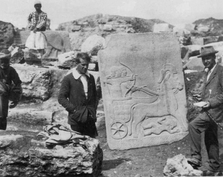 FILE - In this image made available by the Joint Turco-Italian Archaeological Expedition, in this 1913 file photo, a young T.E. Lawrence (of Arabia), left, and C.L. Woolley pictured in front of the Long Wall of Sculpture at Karkemish in Gaziantep province, Turkey. Few archaeological sites seem as entwined with modern conflict as the ancient city of Karkemish, itself the scene of a battle mentioned in the Bible. Smack on the border between Turkey and Syria, where civil war rages, Turkish sentries have long occupied the acropolis and the ruins were recently demined. Visible from earthen ramparts, a Syrian rebel flag flies in a town that regime forces fled months ago. (AP Photo/Courtesy of the Trustees of the Liddell Hart Centre for Military Archives, File)