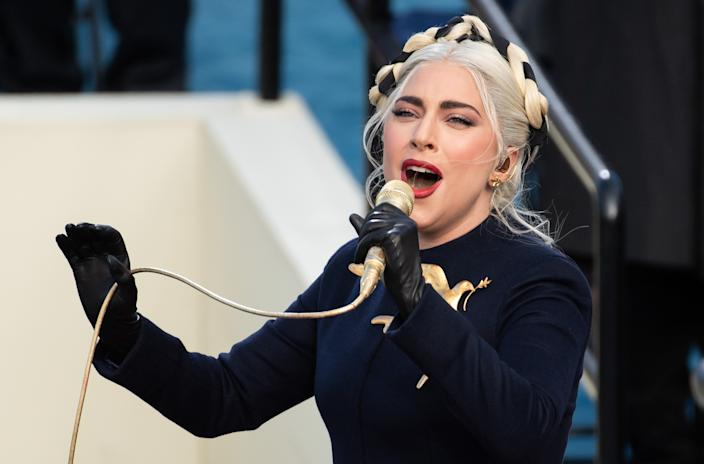 WASHINGTON, DC - JANUARY 20: Singer Lady Gaga (L) performs during the 59th Presidential Inauguration at the U.S. Capitol on January 20, 2021 in Washington, DC. During today's inauguration ceremony Joe Biden becomes the 46th president of the United States. (Photo by Saul Loeb - Pool/Getty Images)