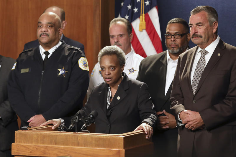 Chicago Mayor Lori Lightfoot, center, has named former Los Angeles police Chief Charlie Beck, right, to be Chicago's interim police superintendent on Friday, Nov. 8, 2019 in Chicago. The announcement comes a day after Superintendent Eddie Johnson, left, announced his retirement after more than three years as the city's police chief and more than 30 years with the department. (AP Photo/Teresa Crawford)