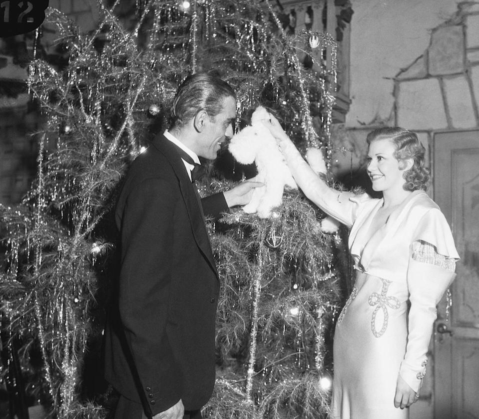 <p>The actress chats with <em>Frankenstein </em>actor Boris Karloff while attending a Hollywood charity gala. </p>