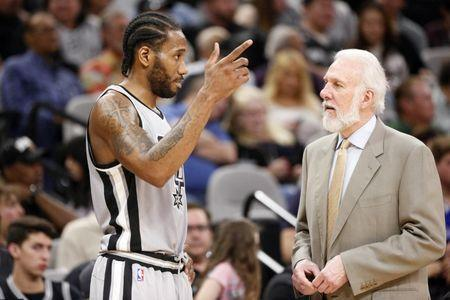 Mar 19, 2017; San Antonio, TX, USA; San Antonio Spurs small forward Kawhi Leonard (2) talks with head coach Gregg Popovich during the second half against the Sacramento Kings at AT&T Center. Mandatory Credit: Soobum Im-USA TODAY Sports