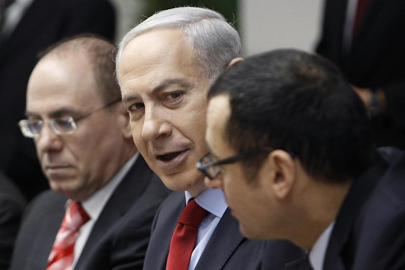 Israeli Prime Minister Benjamin Netanyahu, center, attends the weekly cabinet meeting in his Jerusalem office, Sunday, Dec. 9, 2012. (AP Photo/Ammar Awad, Pool)