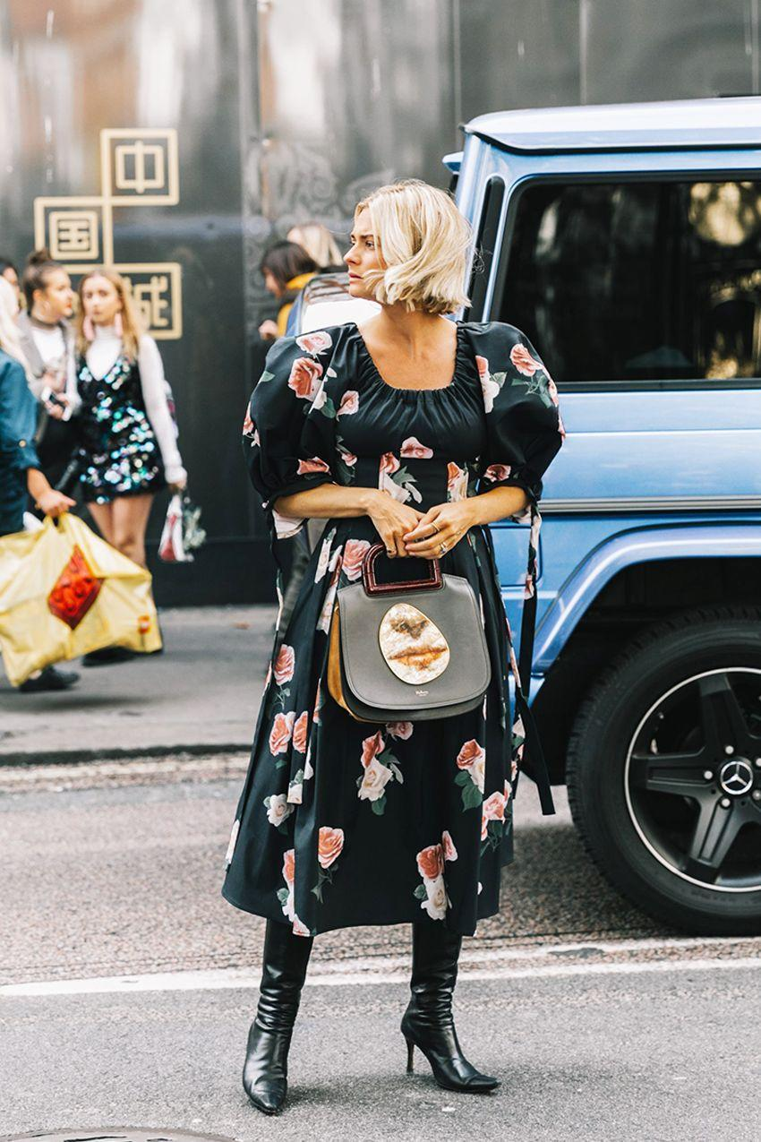 A pair of black leather boots is just what the doctor ordered to bring this summery floral dress into fall.