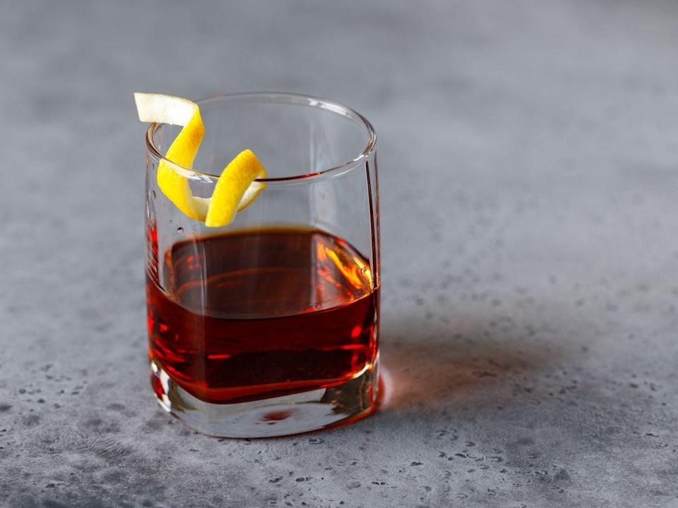 """<p>This potent drink calls for whiskey, sugar, bitters and absinthe, which was illegal in the United States from the 1900s until 2007. If the idea of a liqueur that was once rumored to have caused hallucinations (among other things) makes you a little wary, try the version made at the Sazerac Bar in New Orleans, made with Herbsaint instead.</p><p><em><a href=""""https://www.goodhousekeeping.com/food-recipes/a10676/roosevelt-hotel-new-orleans-sazerac-cocktail-recipe/"""" rel=""""nofollow noopener"""" target=""""_blank"""" data-ylk=""""slk:Get the recipe for Sazerac »"""" class=""""link rapid-noclick-resp"""">Get the recipe for Sazerac »</a></em></p>"""
