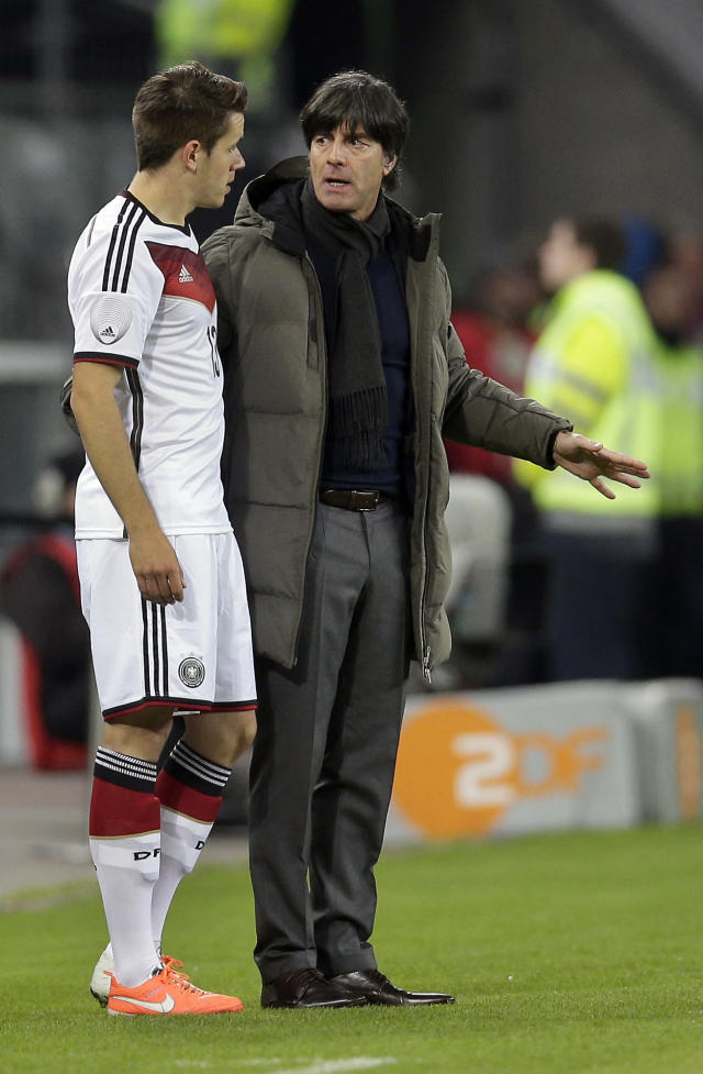 Germany's head coach Joachim Loew, right, talks to Germany's Christian Guenter, left, during a friendly soccer match between Germany and Poland in Hamburg, Germany, Tuesday, May 13, 2014. (AP Photo/Michael Sohn)