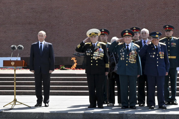 Russian President Vladimir Putin, left, stand, prior to delivering his speech, next to a small group of Russian WWII veterans during a wreath laying ceremony, at the Tomb of Unknown Soldier in Moscow, Russia, Tuesday, June 22, 2021, marking the 80th anniversary of the Nazi invasion of the Soviet Union. (Alexei Nikolsky, Sputnik, Kremlin Pool Photo via AP)