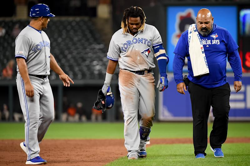 BALTIMORE, MD - SEPTEMBER 18: Vladimir Guerrero Jr. #27 of the Toronto Blue Jays walks off the field after an apparent injury during the ninth inning against the Baltimore Orioles at Oriole Park at Camden Yards on September 18, 2019 in Baltimore, Maryland. (Photo by Will Newton/Getty Images)