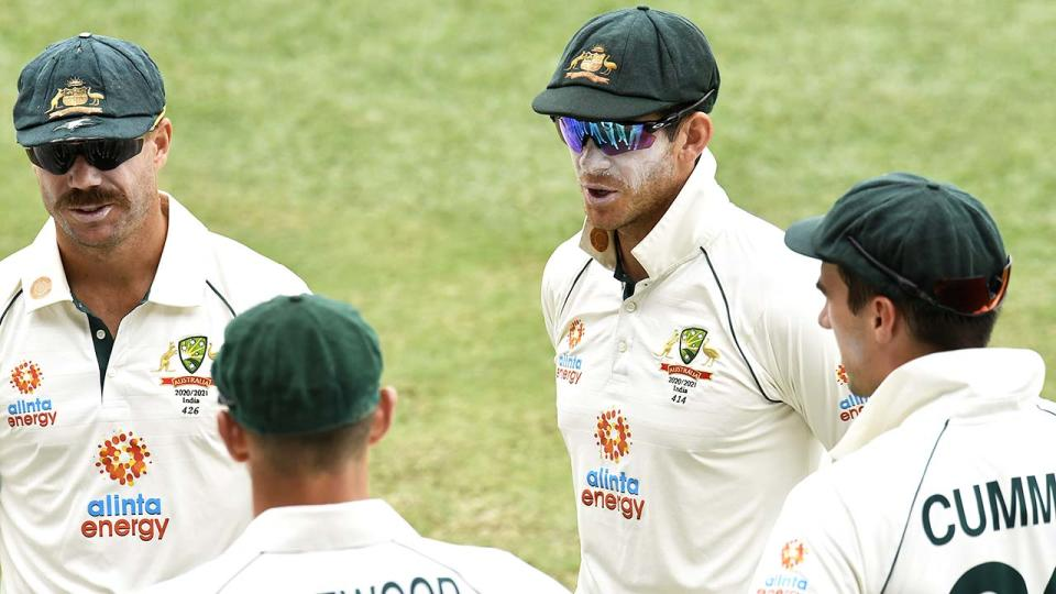 Tim Paine, pictured here speaking to his players during the fourth Test against India.