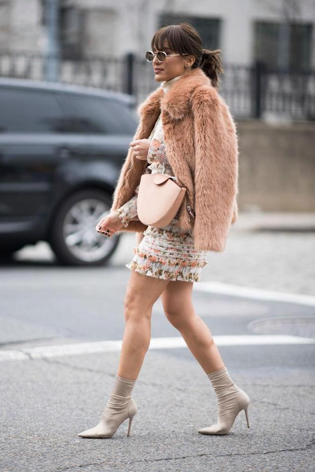 <p>The successful blogger wore something furry to make up for her thigh-baring dress. (Photo: Getty Images) </p>