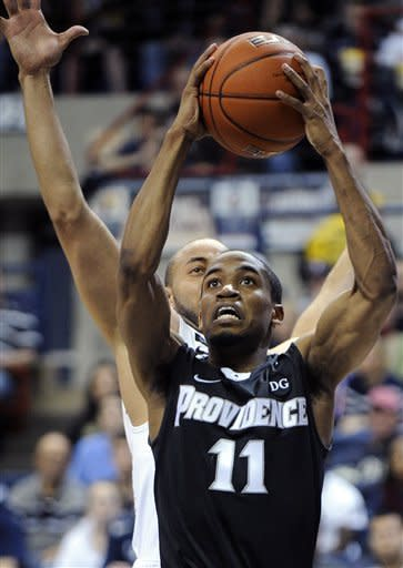Providence's Bryce Cotton (11) is guarded by Connecticut's R.J. Evans during the second half of Connecticut's 63-59 overtime win in an NCAA college basketball game in Storrs, Conn., Saturday, March 9, 2013. (AP Photo/Fred Beckham)