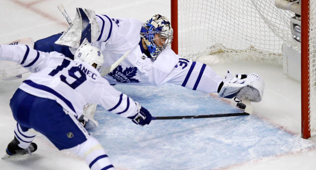 Toronto Maple Leafs goaltender Frederik Andersen and center Tomas Plekanec (19) stretch to make a save against the Boston Bruins during the first period of Game 7 of an NHL hockey first-round playoff series in Boston, Wednesday, April 25, 2018. (AP Photo/Charles Krupa)