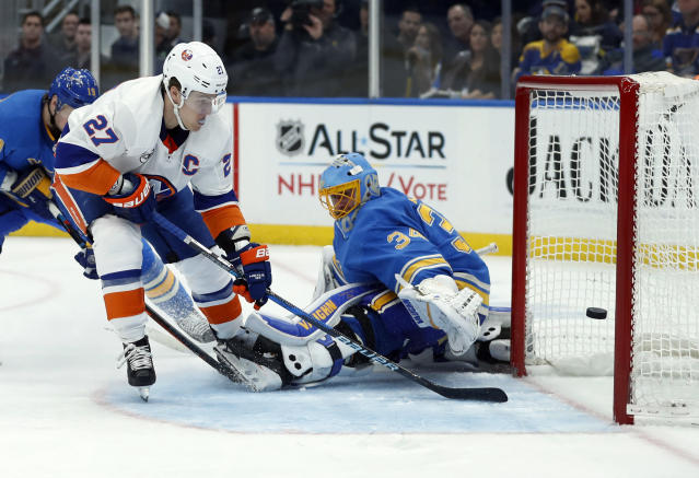 New York Islanders' Anders Lee (27) scores past St. Louis Blues goaltender Jake Allen (34) during the third period of an NHL hockey game Saturday, Jan. 5, 2019, in St. Louis. (AP Photo/Jeff Roberson)