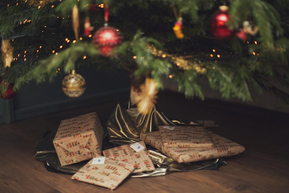 wonderfully wrapped Christmas presents under Christmas tree