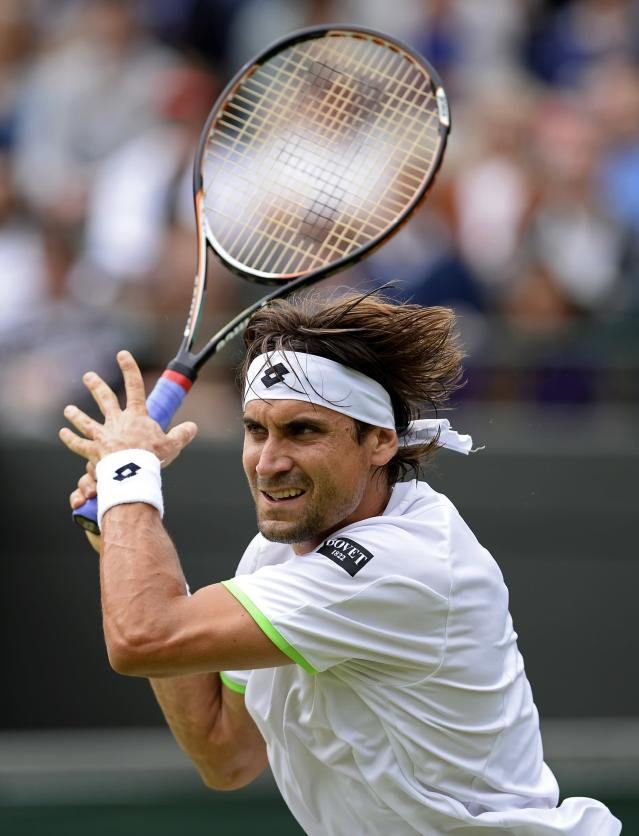 LONDON, ENGLAND - JUNE 28: David Ferrer of Spain hits a backhand during his Gentlemen's Singles second round match against Roberto Bautista Agut of Spain on day five of the Wimbledon Lawn Tennis Championships at the All England Lawn Tennis and Croquet Club on June 28, 2013 in London, England. (Photo by Dennis Grombkowski/Getty Images)
