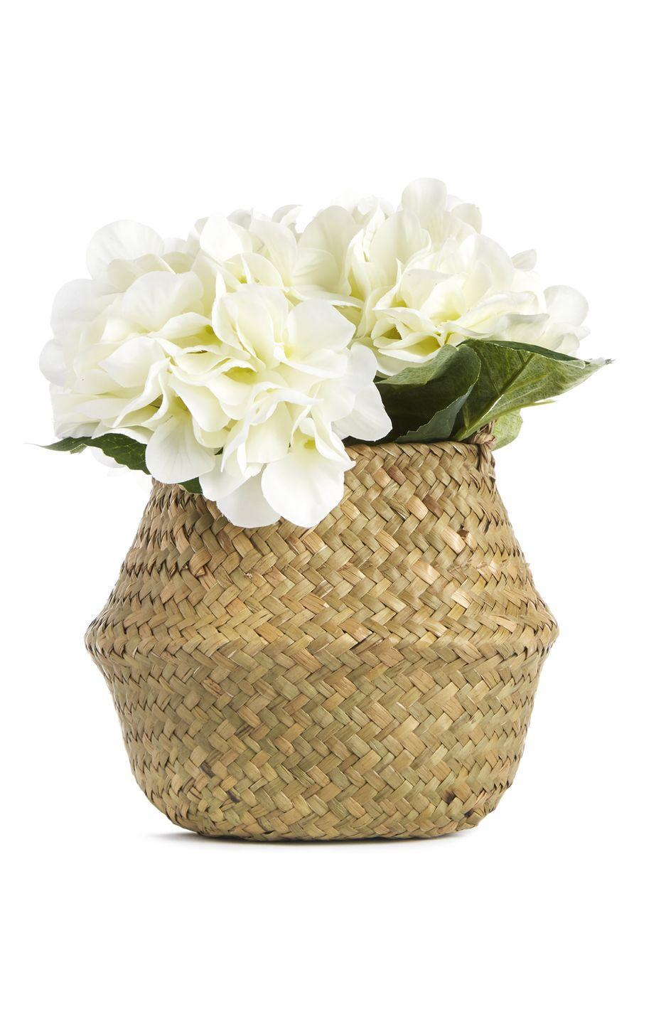 <p>Rattan basket with faux flowers, £8.00</p>
