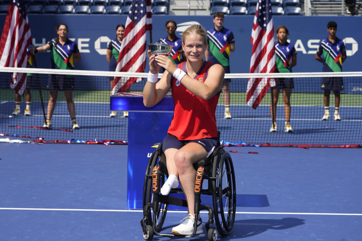 Diede De Groot, of the Netherlands, holds the championship trophy after her victory over Yui Kamiji, of Japan, in the women's wheelchair singles final at the US Open tennis championships, Sunday, Sept. 12, 2021, in New York. (AP Photo/Elise Amendola)
