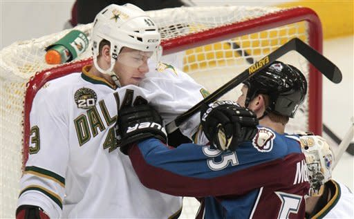 Dallas Stars' Jamie Oleksiak (43) and Colorado Avalanche's Cody McLeod (55) get into a shoving match during the first period of an NHL hockey game on Wednesday, March 20, 2013, in Denver. (AP Photo/Barry Gutierrez)