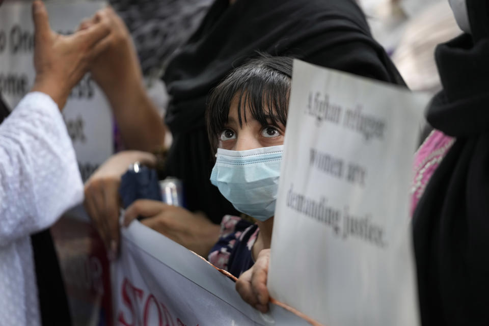 A young Afghan living in Delhi participates in a protest outside the UNHCR office (United Nation High Commissioner for Refugees) in New Delhi, India, Monday, Aug. 23, 2021. Hundreds of Afghans living in India gathered to protest against the Taliban takeover of Afghanistan and also demanded to be given refugee status in India. (AP Photo/Manish Swarup)