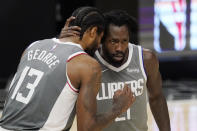 Los Angeles Clippers guard Paul George, left, and guard Patrick Beverley talk during the second half in Game 4 of the NBA basketball Western Conference Finals against the Phoenix Suns Saturday, June 26, 2021, in Los Angeles. (AP Photo/Mark J. Terrill)