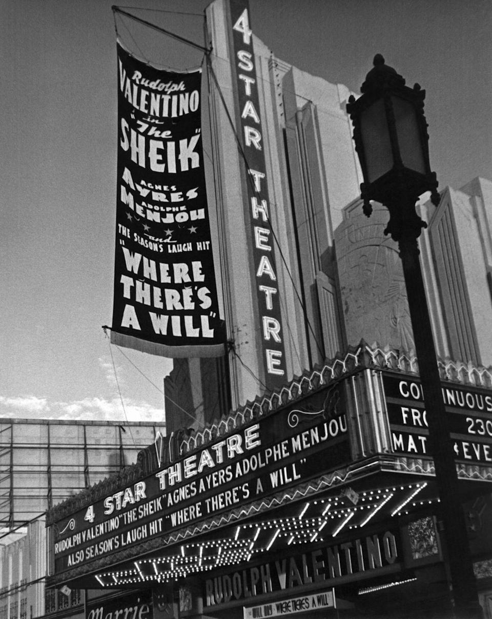 <p>The 4 Star Theater advertises Rudolph Valentino in <em>The Sheik</em> in 1938. Upon closing, the theater space became a church.</p>