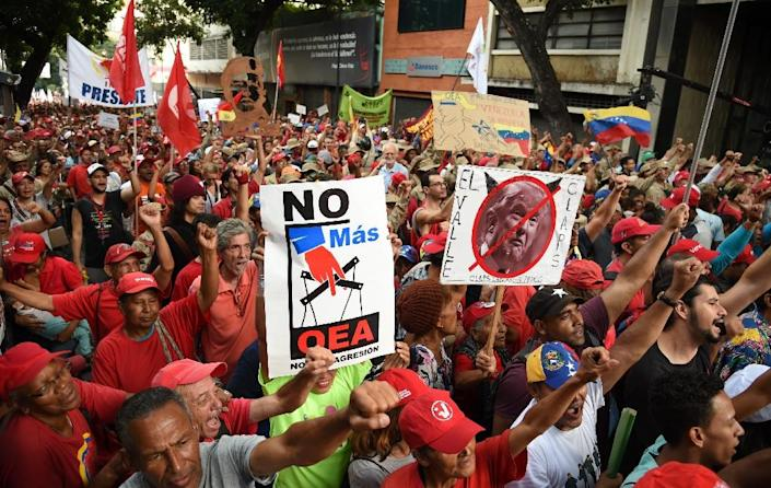 Supporters of Venezuelan President Nicolas Maduro take part in a demonstration called by the presidency to celebrate Venezuela's official exit from the Organization of American States (OAS), at the Bolivar square in Caracas, on April 27, 2019 (AFP Photo/YURI CORTEZ )