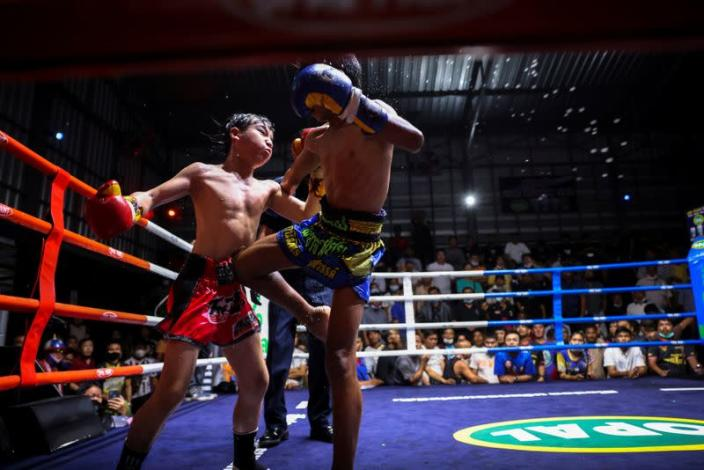 The Wider Image: Punching out of poverty: Despite risks, nine-year-old Thai fighter eager to return to ring