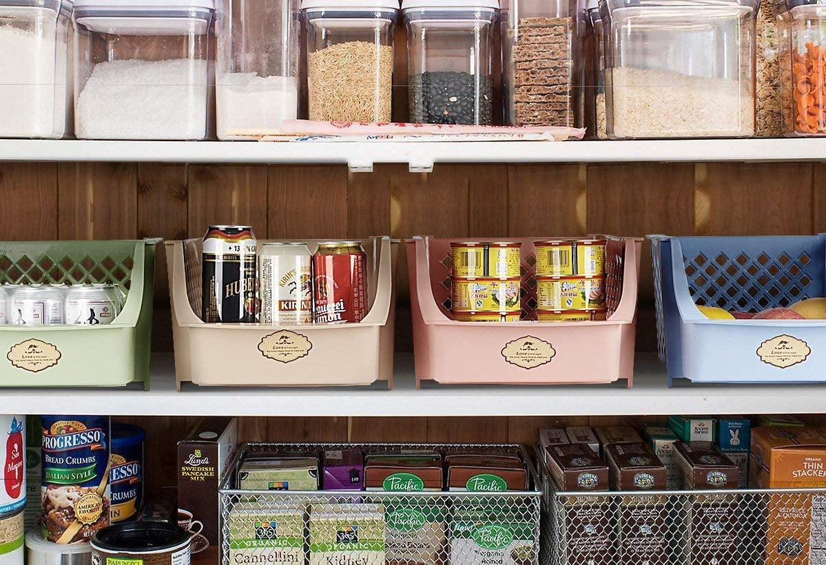 "<p>If you have a large pantry, these <a href=""https://www.popsugar.com/buy/Titan-Mall-Stackable-Storage-Bins-408154?p_name=Titan%20Mall%20Stackable%20Storage%20Bins&retailer=amazon.com&pid=408154&price=37&evar1=casa%3Aus&evar9=46390211&evar98=https%3A%2F%2Fwww.popsugar.com%2Fhome%2Fphoto-gallery%2F46390211%2Fimage%2F46390287%2FTitan-Mall-Stackable-Storage-Bins&list1=shopping%2Corganization%2Chome%20organization%2Chome%20shopping&prop13=api&pdata=1"" rel=""nofollow"" data-shoppable-link=""1"" target=""_blank"" class=""ga-track"" data-ga-category=""Related"" data-ga-label=""https://www.amazon.com/Titan-Mall-Storage-Stackable-Blue-Green-Pink-Khaki/dp/B074BS8JMN/ref=sr_1_33?s=kitchen&amp;ie=UTF8&amp;qid=1548447178&amp;sr=1-33&amp;keywords=kitchen+organization+and+storage"" data-ga-action=""In-Line Links"">Titan Mall Stackable Storage Bins</a> ($37) are great for snacks or larger items.</p>"